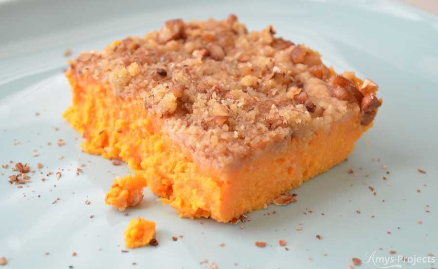 A delicious sweet potato casserole recipe topped with yummy pecans.